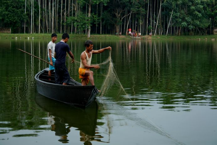 Community members of Kodhaldawa engaged in fishing Image